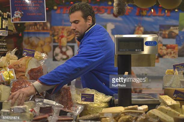 A stall holder selling Italian cheeses at the European Christmas market in Manchester England on Wednesday 25th November 2015