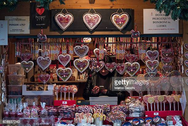 A stall holder shows traditional products at the Christmas market on December 10 2016 in Ljubljana Slovenia The traditional Christmas market and...