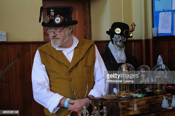 A stall holder tends his goods as steampunk enthusiasts attend the Asylum Steampunk festival on August 28 2015 in Lincoln England The Asylum...
