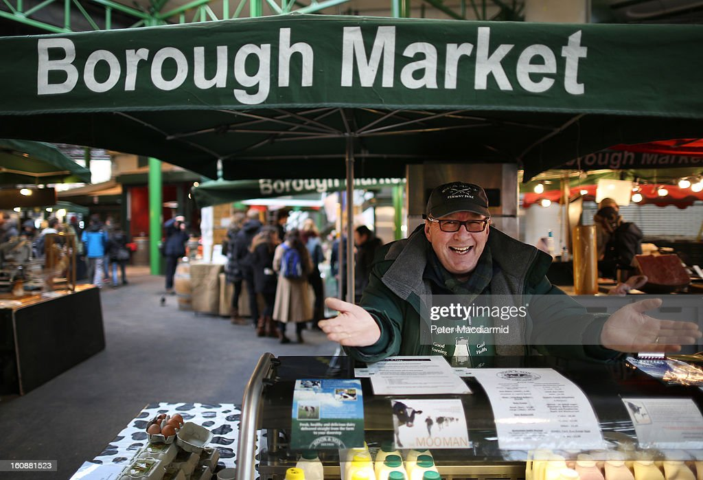 Stall holder Tony Vintner sells milk at Borough Market on February 7, 2013 in London, England. Borough Market, London's oldest since 1756, has recently completed renovation and today had it's first day of full trading.