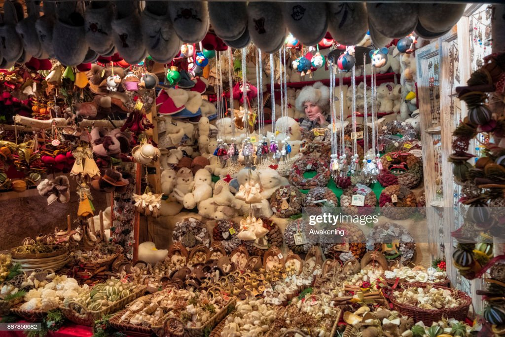 Stall holders wait for customer at the Vorosmarty Square Christmas market on December 7, 2017 in Budapest, Hungary. The traditional Christmas market and lights will stay until 31st December 2017.