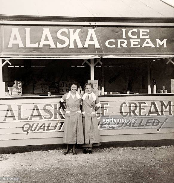 A stall selling Alaska Ice Cream with two serving girls during the Adelaide Show in Australia circa 1923