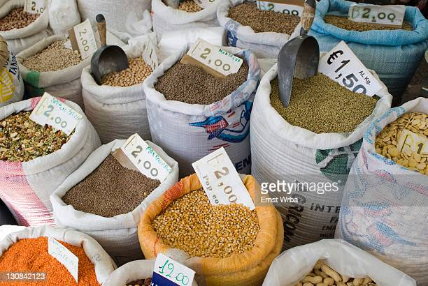 stall selling legumes in sacks at the weekly market in locorotondo, apulia, italy - locorotondo stock photos and pictures