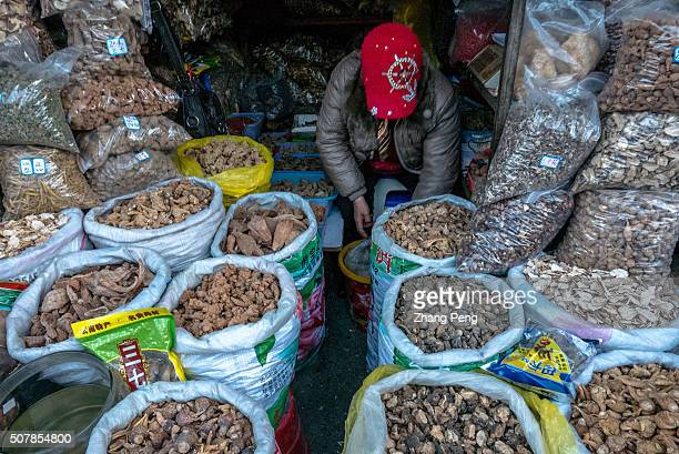 Stall selling Maca which is very popular used as a root vegetable and a medicinal herb Zhongyi market located at the southern gate of Dayan ancient...
