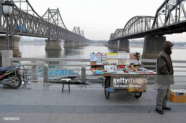 Stall selling North Korea related souvenirs is open as usual at the China-North Korea border city on December 12, 2012 in Dandong, China. North Korea...