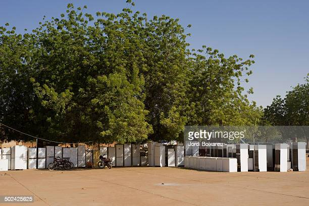 CONTENT] Stall selling refrigerators in the streets of Niamey Niger