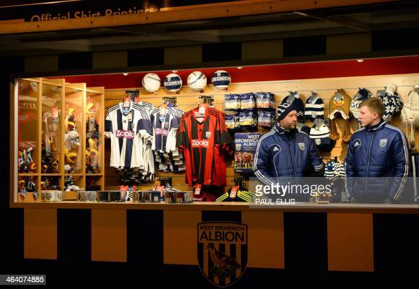 A stall selling West Bromwich Albion merchandise including the team's shirt bearing the Zoopla sponsorship logo is pictured before the English...