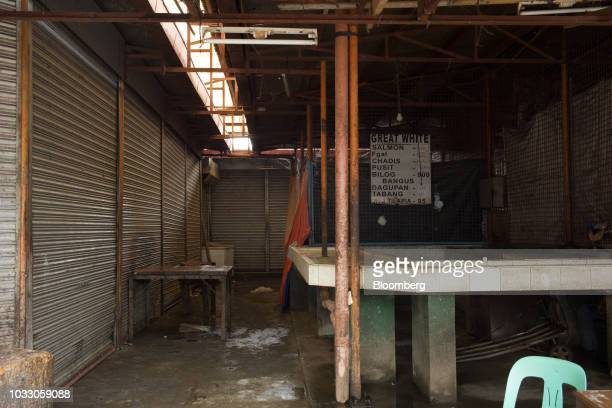 A stall stands empty at a market ahead of Typhoon Mangkhut's arrival in Tuguegarao Cagayan province the Philippines on Friday Sept 14 2018...