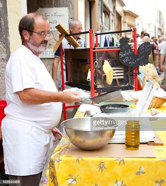 stall vendor tossing pancakes