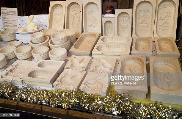 Stall with handcrafted wooden objects Christmas market in Aachen North RhineWestphalia Germany