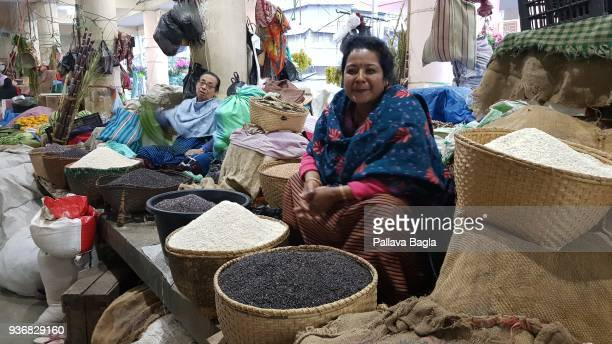 A stallholder displays and sells rice in a marketplace on March 17 2018 in Imphal Manipur India In this northeastern tip of India in the state of...