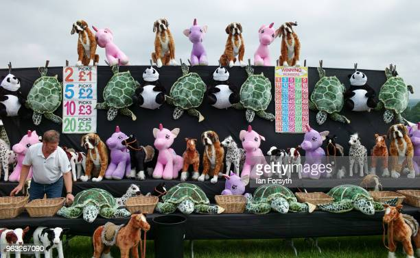 A stallholder selling stuffed toy animals prepares his stall ahead of the Duncombe Park Country Fair on May 28 2018 in Helmsley England Set in the...