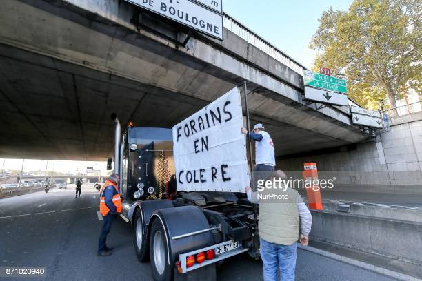 Stallholders take part in a goslow operation with their trucks on November 6on the boulevard peripherique in Paris to protest against the...