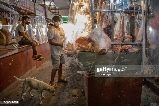 Stalls inside a wet market are seen covered in plastic to enforce social distancing on March 30, 2020 in Las Pinas, Metro Manila, Philippines. The...