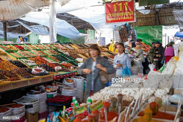 Stalls offering dried fruit, nuts and spices for sale at food market in Bishkek, capital city of Kyrgyzstan.