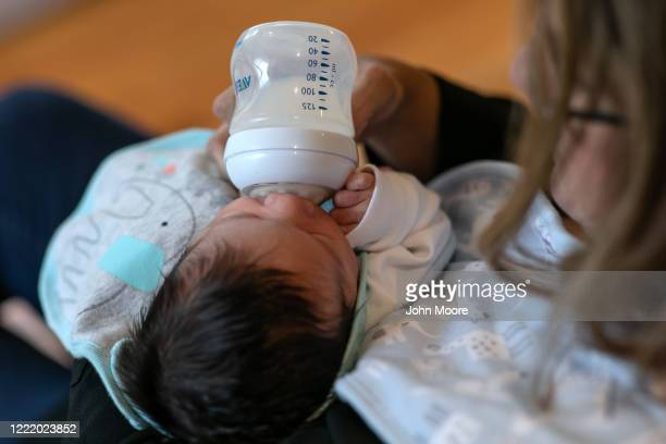 Stamford Elementary school teacher Luciana Lira feeds baby Neysel then 2 1/2 weeks on April 20 2020 in Stamford Connecticut Lira is caring for the...