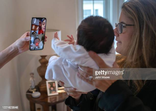Stamford Elementary school teacher Luciana Lira holds baby Neysel then 2 1/2 weeks while showing the newborn for the first time to his immigrant...