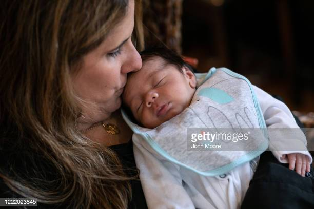 Stamford Elementary school teacher Luciana Lira holds baby Neysel then 2 1/2 weeks on April 20 2020 in Stamford Connecticut Lira is caring for the...