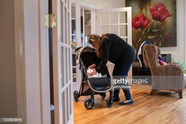Stamford Elementary school teacher Luciana Lira tends to baby Neysel then 2 1/2 weeks on April 20 2020 in Stamford Connecticut Lira is caring for the...