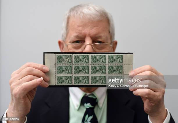 Stamp dealer Michael Chipperfield holds a collection of twelve SG 403 pound1 green stamps 1913 Waterlow Printing seahorse issue worth pound125 during...