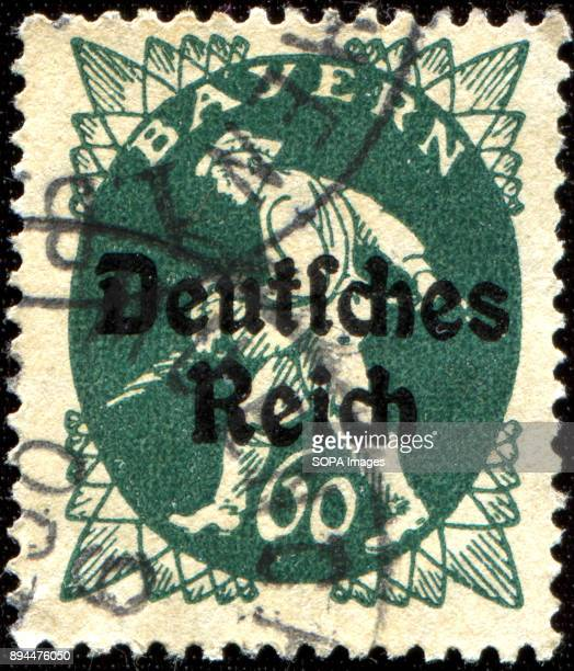 CIRCA 1920 A stamp printed in Bavaria with a 'Deutsches Reich' overprint shows sower
