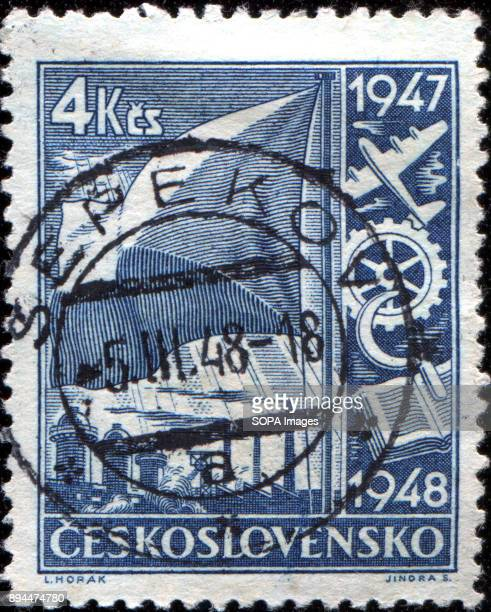 CIRCA 1947 A stamp printed in Czechoslovakia shows Flag and Symbols of Transport Industry Agriculture and Learning