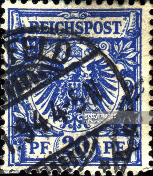 CIRCA 1884 A stamp printed in Germany shows coat of arms of Germany