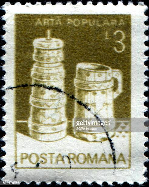 A stamp printed in Romania 1982 shows Butter churn wooden bucket from Moldavia folk art series