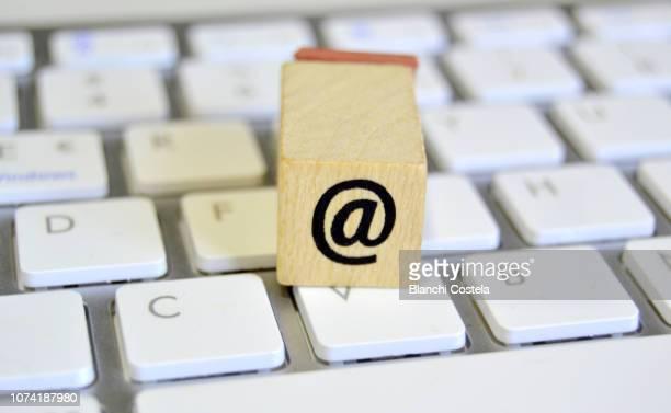 stamp with the at symbol on a wireless keyboard - klaverin och tangentinstrument bildbanksfoton och bilder