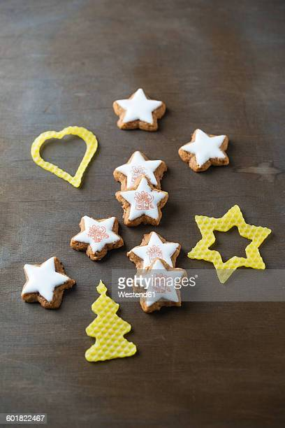 Stamped cinnamon stars and Christmas decoration made of beeswax