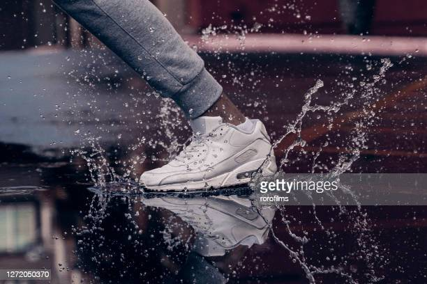 stamping foot - 靴底 ストックフォトと画像