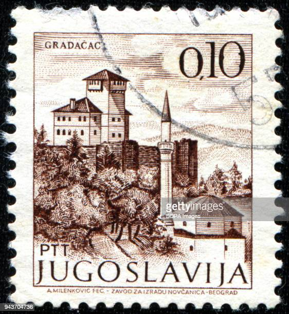 CIRCA 1961 Stamps printed in Yugoslavia shows a monastery on top of a hill and a muslim mosque with a minaret in the town of Gradacac Bosnia