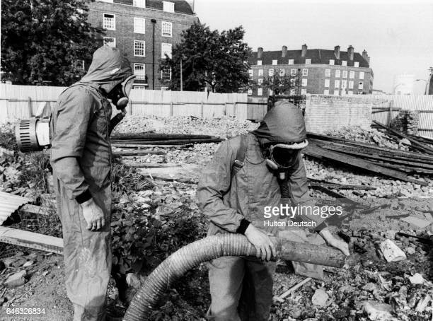 Stan Charles and his supervisor get ready to clean up asbestos at a wrecked building