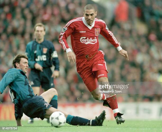 Stan Collymore of Liverpool avoids a challange from Andy Linighan of Arsenal during an FA Carling Premiership match at Anfield on December 23 1995 in...