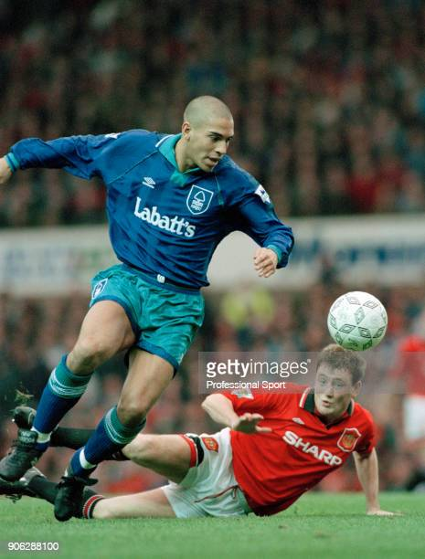 Stan Collymore of Nottingham Forest evades challenge by Steve Bruce of Manchester United during an FA Carling Premiership match at Old Trafford on...