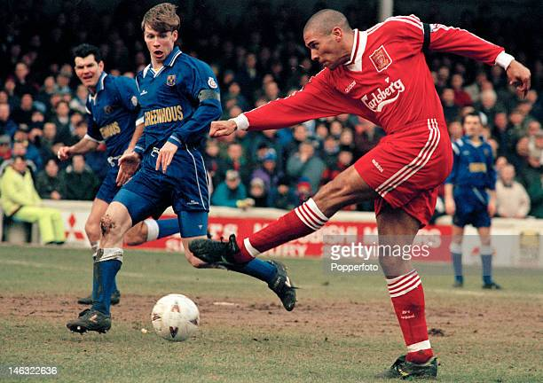 Stan Collymore scores for Liverpool during their FA Cup 4th round match against Shrewsbury Town at Gay Meadow in Shrewsbury 27th January 1996...