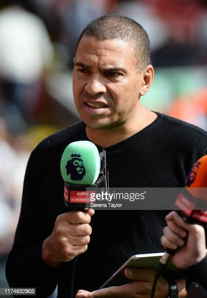 Stan Collymore talks to the Premier League during the Premier League match between Liverpool FC and Newcastle United at Anfield on September 14 2019...