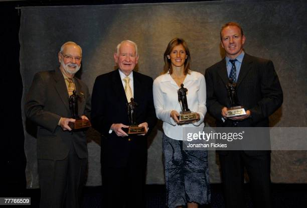 Stan Fischler John Halligan Cammi Granato and Brian Leetch pose with the 2007 Lester Patrick Award during a media availability November 7 2007 in New...