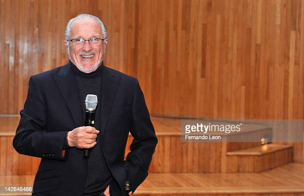 Stan Herman poses for pictures onstage at The Fashion Institute of Technology on April 10 2012 in New York City