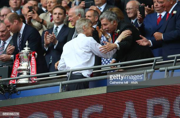 Stan Kroenke congratulates Arsene Wenger manager / head coach of Arsenal during the Emirates FA Cup Final match between Arsenal and Chelsea at...