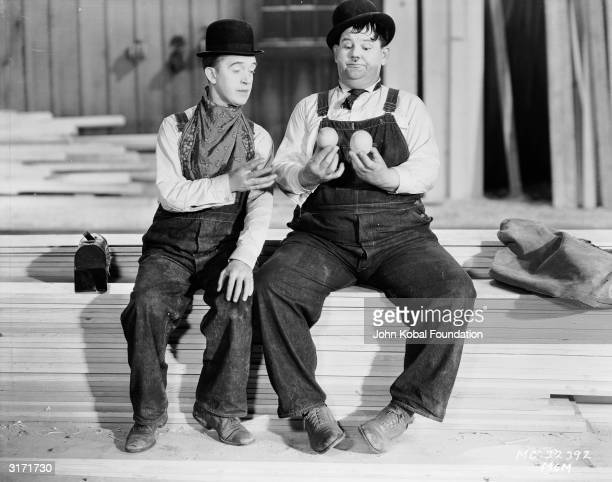 Stan Laurel and Oliver Hardy break for lunch in a scene from 'Busy Bodies' directed by Lloyd French