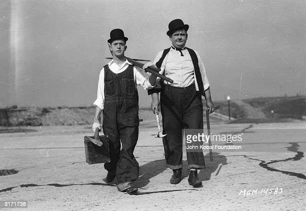 Stan Laurel and Oliver Hardy in a publicity still for 'The Finishing Touch' directed by Leo McCarey and Clyde Bruckman