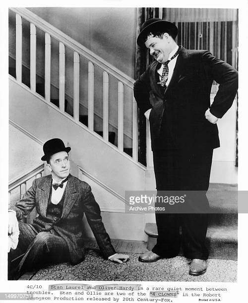 Stan Laurel and Oliver Hardy in a rare quiet moment in between troubles in a scene from the film '4 Clowns' 1970