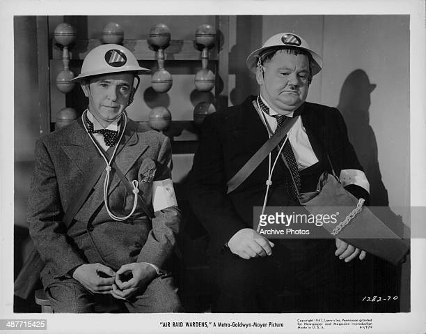 Stan Laurel and Oliver Hardy in a scene from the movie 'Air Raid Wardens' 1943