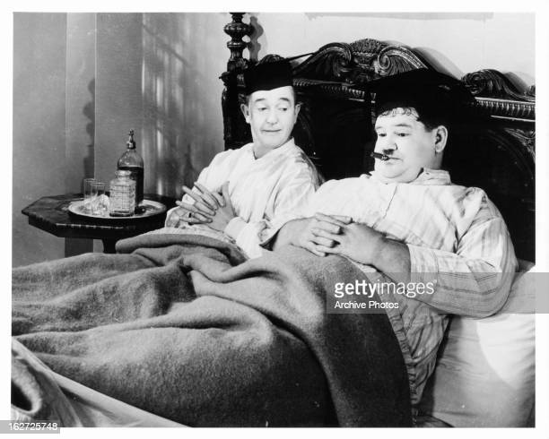 Stan Laurel and Oliver Hardy in bed in a scene from the film 'A Chump At Oxford' 1940