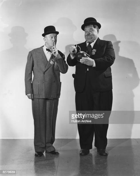 Stan Laurel and Oliver Hardy play two incompetent detectives in the film 'The Big Noise', directed by Mal St Clair for 20th Century Fox.