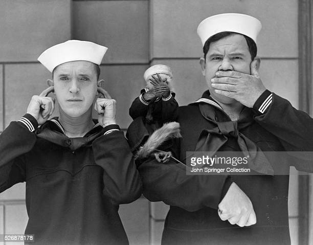 Stan Laurel and Oliver Hardy together with their new leading lady Mary the monkey exemplify the motto See no evil hear no evil and speak no evil