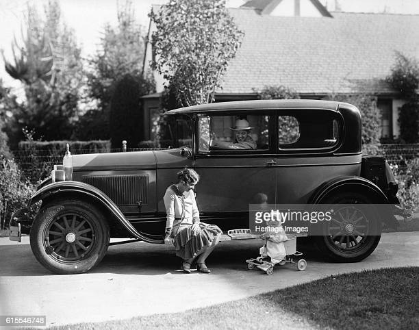 Stan Laurel at the wheel of 1927 Hupmobile with his wife Lois and daughter Lois Artist Unknown