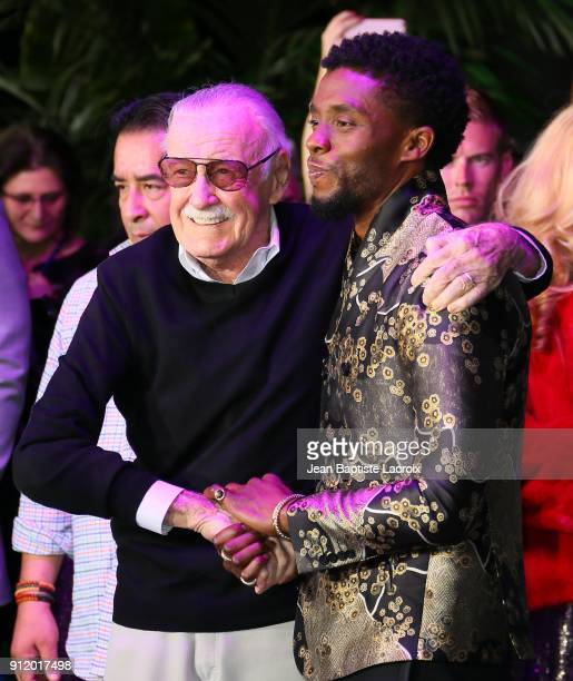 Stan Lee and Chadwick Boseman attend the premiere of Disney and Marvel's 'Black Panther' on January 28 2018 in Los Angeles California