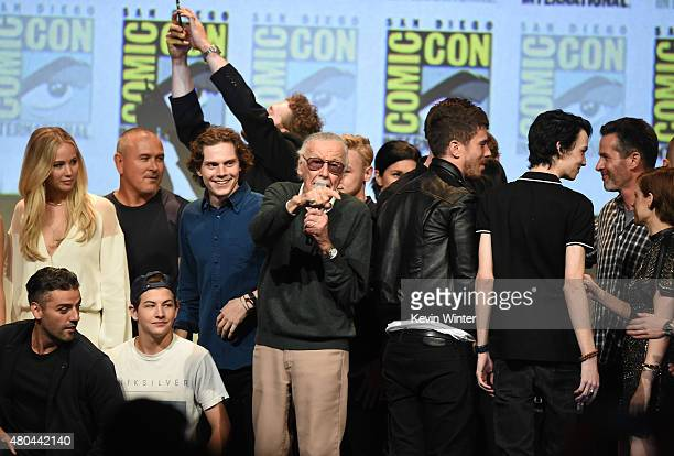 Stan Lee appears with cast members from XMen movies onstage at the 20th Century FOX panel during ComicCon International 2015 at the San Diego...